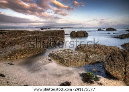 Water between the rocks of a beach - stock photo