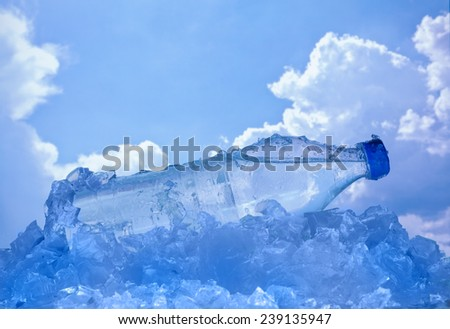 water bottle lies on ice - stock photo