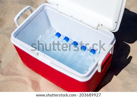 water bottles in a box with ice - stock photo