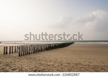 water breakers on the beach of Domburg, Walcheren, Zeeland, The Netherlands - stock photo