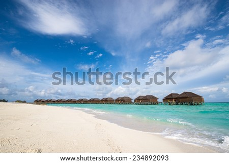 Water bungalow, tropical beach, Maldives - stock photo
