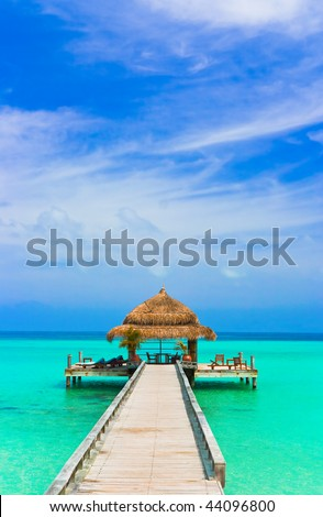 Water cafe on the beach and pathway - stock photo