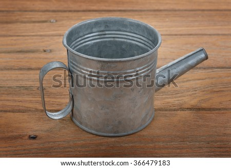 water cans made of tin - stock photo