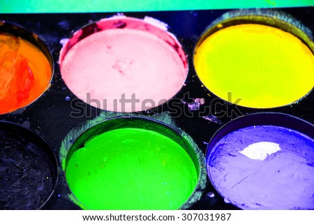 Water color drawing, paints and brushes - stock photo