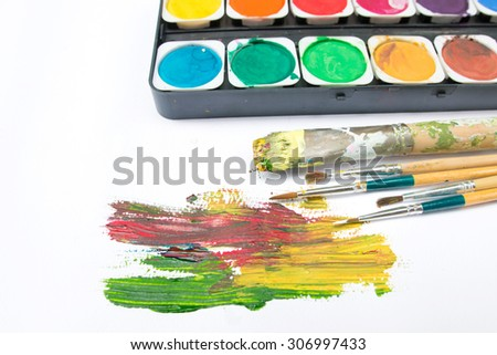 water-color paint-box and paint brush. - stock photo