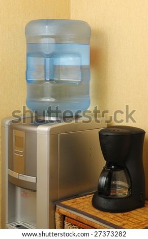 Water cooler and coffee machine in a office - stock photo