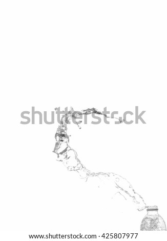 Water distribution out of the bottle on white background. - stock photo