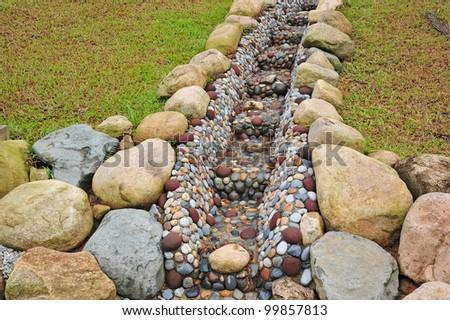 Water Drain In The Garden - stock photo