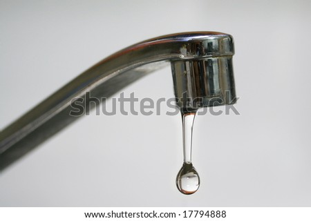 water drop falling from a kitchen tap - stock photo