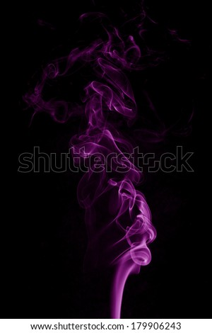 Water drop falling into violet water - stock photo