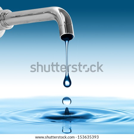 Water drop from water tap - stock photo