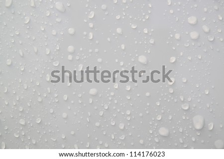 Water droplets on a white background. - stock photo
