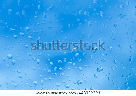 Water droplets on glass with blue background. - stock photo