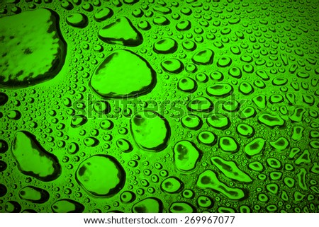 Water droplets on green metal - a beautiful unusual texture - stock photo