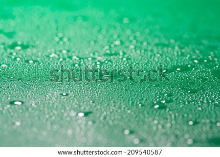 Water droplets on green surface as background - stock photo