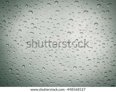 Water drops background on glass window. - stock photo