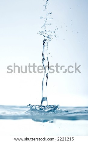water drops falling on still surface - stock photo