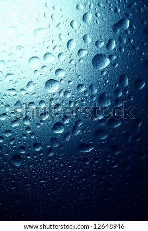 water drops on a blue textured background - stock photo