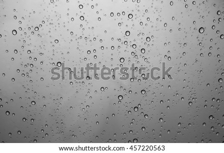 Water drops on a dark background - stock photo