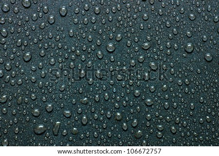 water drops on a dark surface - stock photo