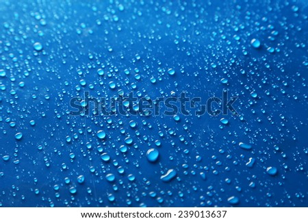 Water drops on blue background - stock photo
