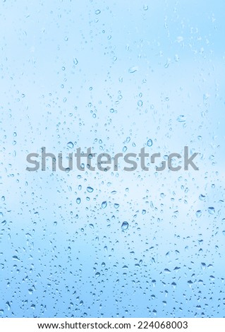 water drops on blue glass - stock photo