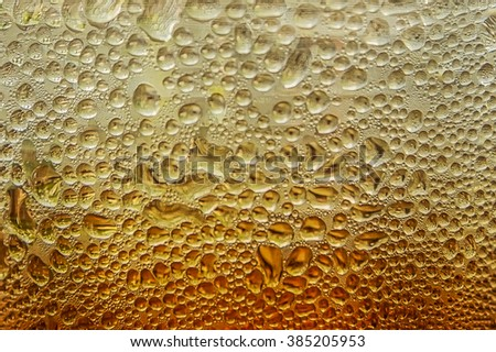 water drops on Cola glass background - stock photo