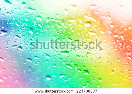 water drops on colorful blur background - stock photo