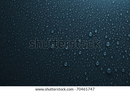 water drops on dark blue - stock photo