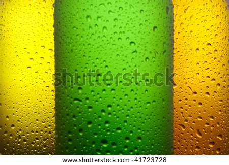 Water drops on different color glass bottles - stock photo