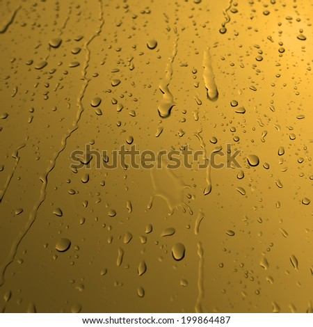 Water drops on glass in yellow - stock photo