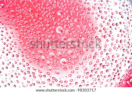 Water drops on glass red and white color - stock photo