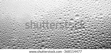 Water drops on glass texture - stock photo