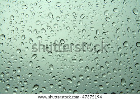 water drops on glass window - stock photo
