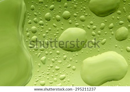 Water drops on gresh green natural background. - stock photo