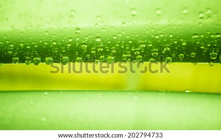 Water drops on metal surface texture in green tone    - stock photo