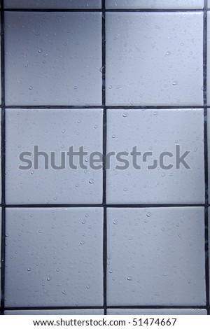 Water drops on shower tiles - stock photo