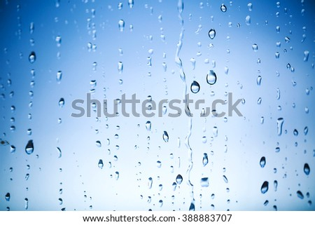Water drops on the window - stock photo