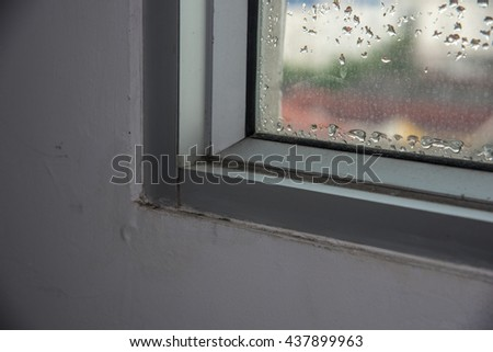 water drops on window ,Moisture causes mold - stock photo