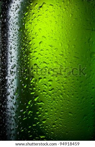 Water drops texture on the bottle of beer. Abstract background with selective focus - stock photo