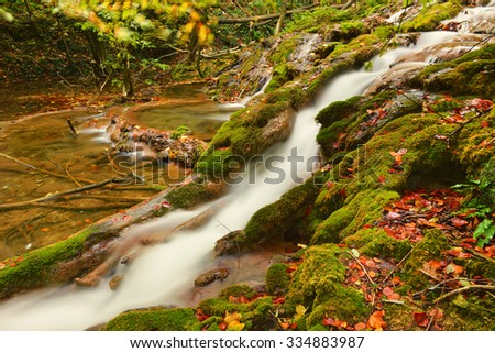 water fall in the autumn forest, beautiful pond in the woods, Ochiul Beiului, Caras Severin county, Romania,   - stock photo