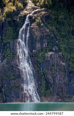 Water fall on a rock in the Vicente Perez Rosales National Park, Chile - stock photo