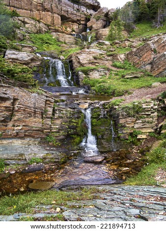 Water Fall, Waterton National Park, Alberta, Canada These falls flow out from Carthew Lakes and are on the hike from Cameron Lake to Waterton town site. - stock photo