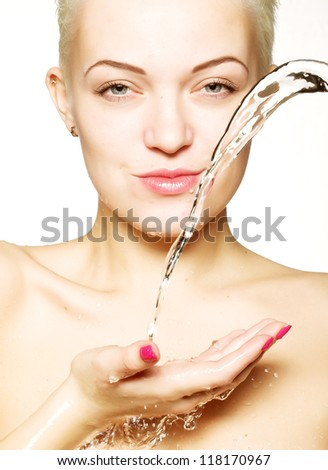 Water falling on the beautiful sensuality woman face with clean skin - stock photo