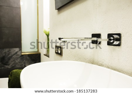 Water faucet and sink in a bathroom, shallow DOF - stock photo