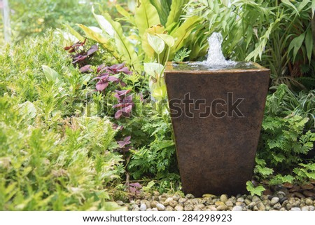 water feature in garden is Chinese belief   fountain from pot  put on right front of house is lucky - stock photo