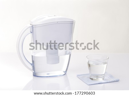 water filter jug and a glass of water - stock photo