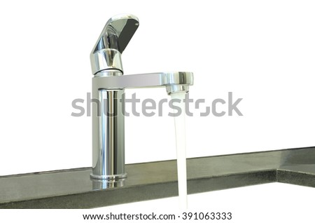Water flow faucet granite counter on white background. - stock photo