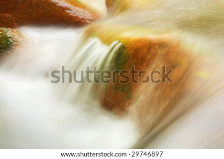 water flow with stone - stock photo
