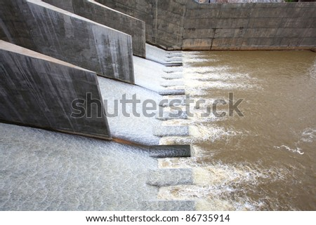 water flowing from dam gate for power environment concept - stock photo